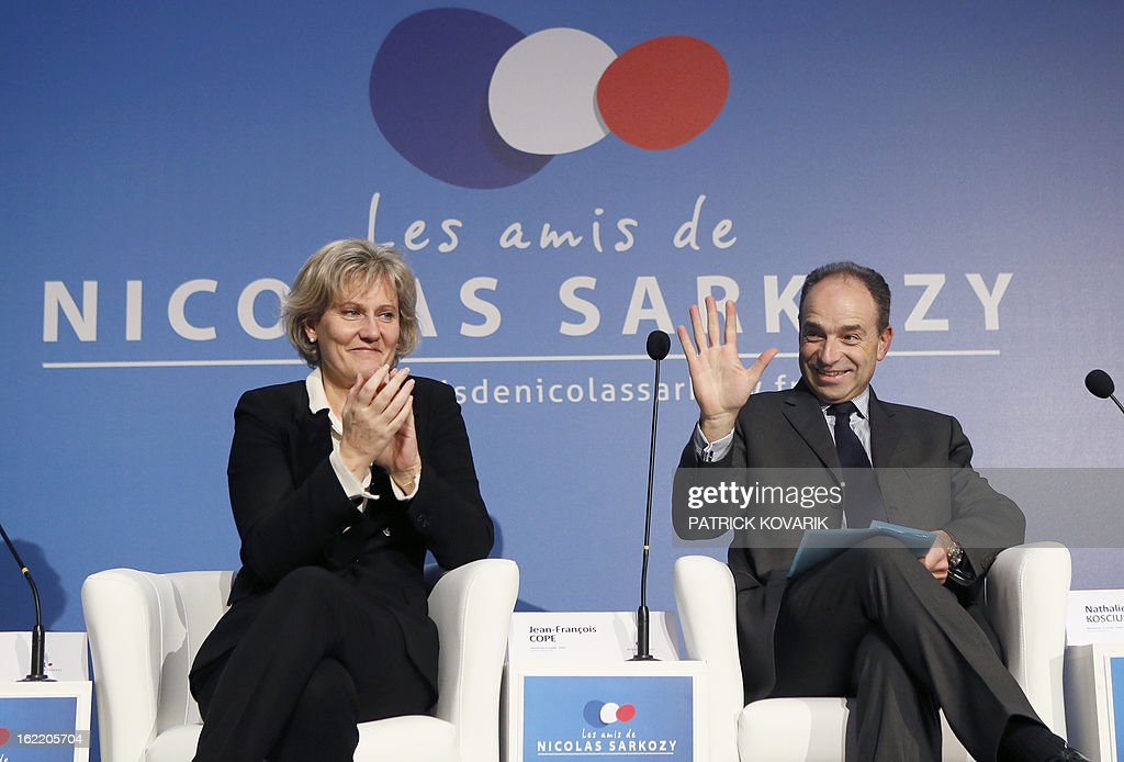 France's right-wing opposition UMP leader Jean-Francois Cope (R) and former minister Nadine Morano (L) take part in a meeting of the association 'The friends of Nicolas Sarkozy', on February 20, 2013 in Paris. Former French Prime Minister Alain Juppe declared to French media on February 13, 2013 that former French President Sarkozy is willing to run for France's next Presidential elections in 2017, adding that Sarkozy 'follows with much attention the political affairs'.
