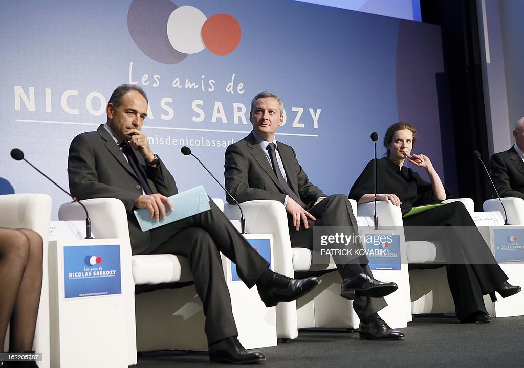 France's right-wing opposition UMP leader Jean-Francois Cope and former ministers Bruno Le Maire and Nathalie Kosciusko-Morizet takes part in a meeting of the association 'The friends of Nicolas Sarkozy', on February 20, 2013 in Paris. Former French Prime Minister Alain Juppe declared to French media on February 13, 2013 that former French President Sarkozy is willing to run for France's next Presidential elections in 2017, adding that Sarkozy 'follows with much attention the political affairs'.