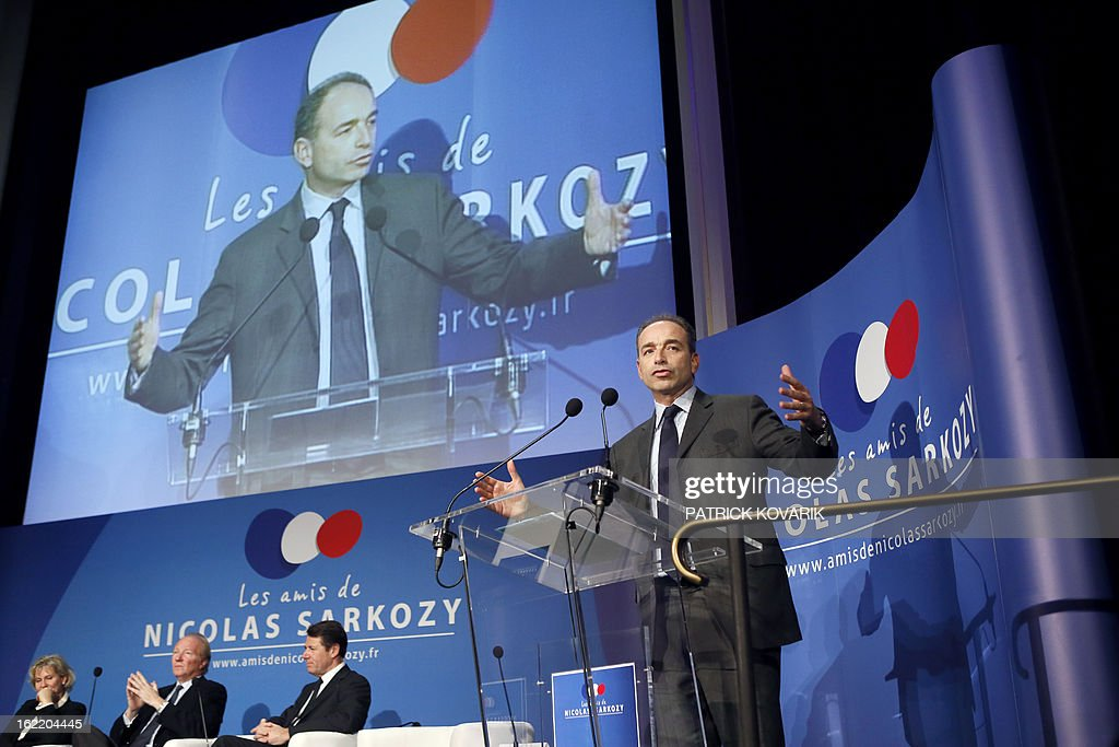France's right-wing opposition UMP leader Jean-Francois Cope (R) delivers a speech during a meeting of the association 'The friends of Nicolas Sarkozy', on February 20, 2013 in Paris. Former French Prime Minister Alain Juppe declared to French media on February 13, 2013 that former French President Sarkozy is willing to run for France's next Presidential elections in 2017, adding that Sarkozy 'follows with much attention the political affairs'. Background, (from L), French formers ministers, Nadine Morano, Brice Hortefeux and Mayor of Nice Christian Estrosi.