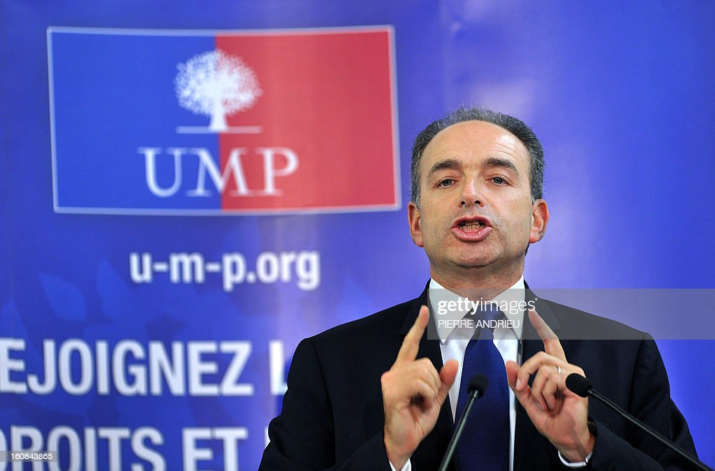 France's right-wing opposition UMP leader Jean-Francois Cope gestures as he speaks, on February 6, 2013 during a meeting in Agen.