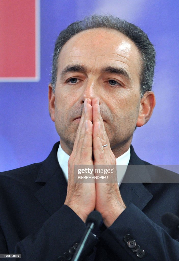 France's right-wing opposition UMP leader Jean-Francois Cope gestures, on February 6, 2013 during a meeting in Agen.