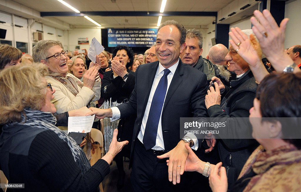 France's right-wing opposition UMP leader Jean-Francois Cope meets with supporters on February 6, 2013 during a meeting in Agen.