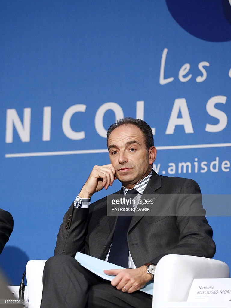 France's right-wing opposition UMP leader Jean-Francois Cope takes part in a meeting of the association 'The friends of Nicolas Sarkozy', on February 20, 2013 in Paris. Former French Prime Minister Alain Juppe declared to French media on February 13, 2013 that former French President Sarkozy is willing to run for France's next Presidential elections in 2017, adding that Sarkozy 'follows with much attention the political affairs'.
