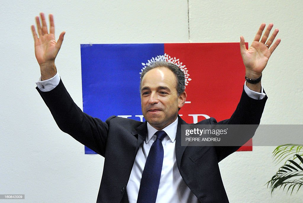 France's right-wing opposition UMP leader Jean-Francois Cope waves to supporters on February 6, 2013 during a meeting in Agen. AFP PHOTO / PIERRE ANDRIEU