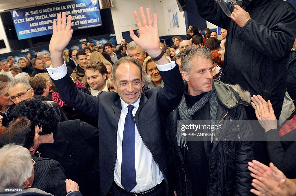 France's right-wing opposition UMP leader Jean-Francois Cope waves to supporters on February 6, 2013 upon arrival during a meeting in Agen. AFP PHOTO / PIERRE ANDRIEU