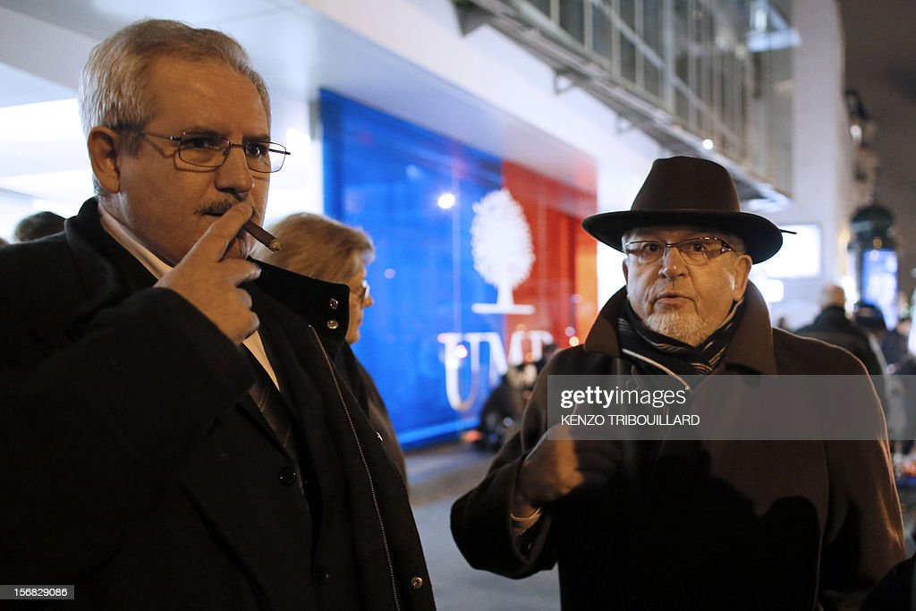 France's right-wing UMP opposition militants stage a protest outside the party headquarters on November 22, 2012 demanding that their party heads 'enter into conclave', cease making press declarations and talk to each other in a bid to find a solution to the governance of the party. UMP was in disarray today as top officials wrangled over the results of a leadership vote that the party admitted may have been flawed. The UMP's top electoral committee said that the results would 'in all likelihood' be different if all the votes were taken into account and asked the party's appeals body to take a decision. AFP PHOTO / KENZO TRIBOUILLARD