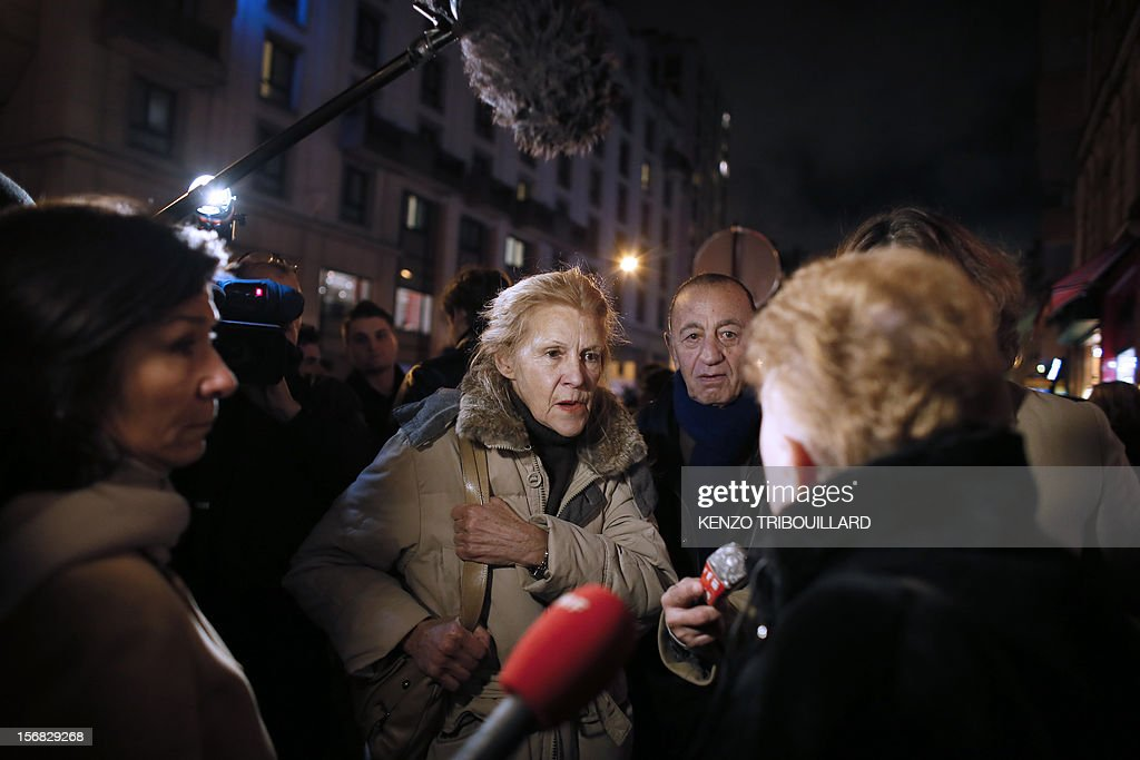 France's right-wing UMP opposition militants talk to the press as they stage a protest outside the party headquarters on November 22, 2012 demanding that their party heads 'enter into conclave', cease making press declarations and talk to each other in a bid to find a solution to the governance of the party. UMP was in disarray today as top officials wrangled over the results of a leadership vote that the party admitted may have been flawed. The UMP's top electoral committee said that the results would 'in all likelihood' be different if all the votes were taken into account and asked the party's appeals body to take a decision. AFP PHOTO / KENZO TRIBOUILLARD