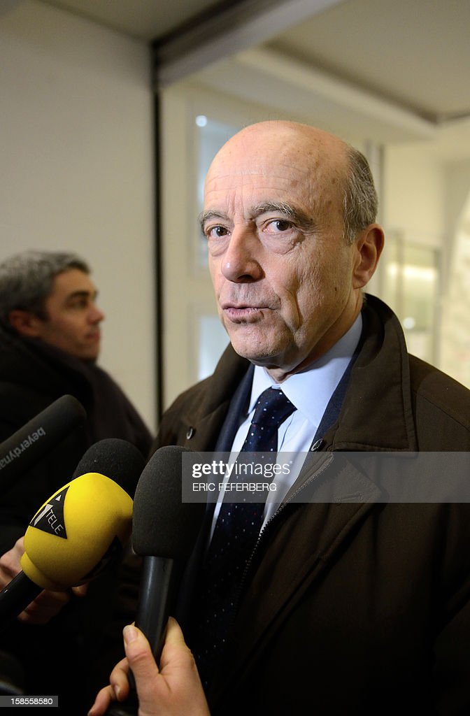 France's rightwing UMP party former minister Alain Juppe addresses journalists as he arrives the party's headquarters to attend a political committee meeting on December 19, 2012 in Paris. The meeting comes two days after rivals in a bitter leadership row that split France's former ruling party agreed to a new internal election after a contested first vote last month.