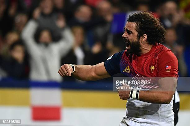 France's rightwing Yaonn Huget reacts after scoring a try during the friendly rugby test match between France and Samoa at the Stadium Municipal in...