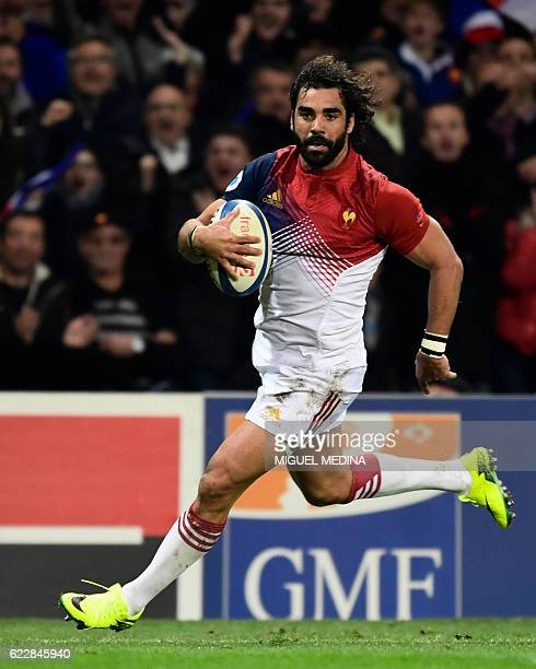 France's rightwing Yaonn Huget runs to score a try during the friendly rugby test match between France and Samoa at the Stadium Municipal in Toulouse...