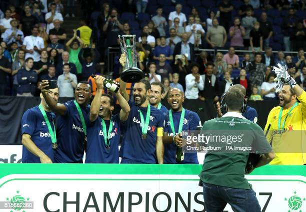 France's Robert Pires lifts the Star Sixes trophy after his Side won the Tournament at The O2 Arena London