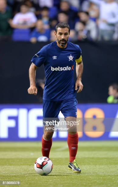 France's Robert Pires runs with the ball during the Star Sixes final football match between France and Denmark at the O2 Arena in London on July 16...