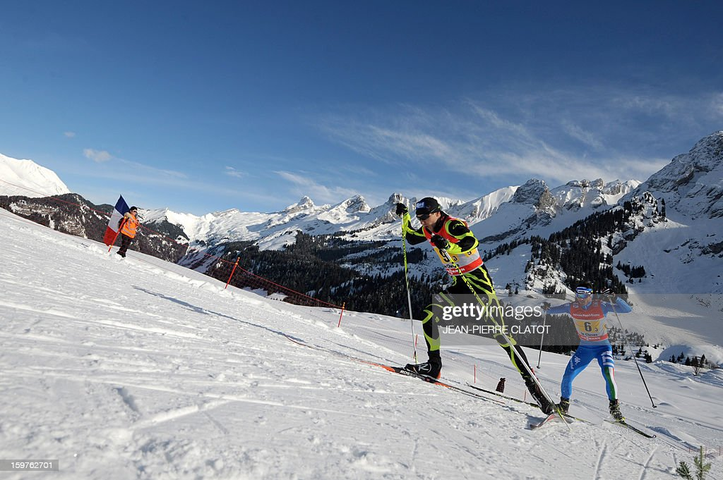 France's Robin Duvillard (L) and Italy's Roland Clara compete in the Nordic skiing combined World Cup relay (4 x 7,5 km) on January 20, 2013 in La Clusaz, eastern France. AFP PHOTO JEAN-PIERRE CLATOT