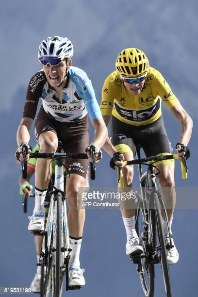 France's Romain Bardet and Great Britain's Christopher Froome wearing the overall leader's yellow jersey ride towards the finish line at the end of...