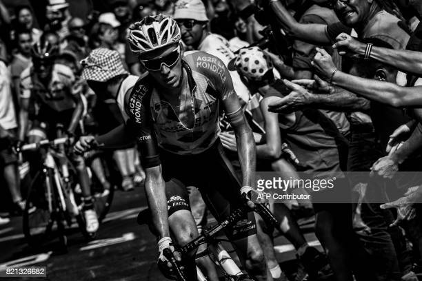 France's Romain Bardet and Spain's Alberto Contador ride in a breakaway past supporters during the 1895 km fifteenth stage of the 104th edition of...