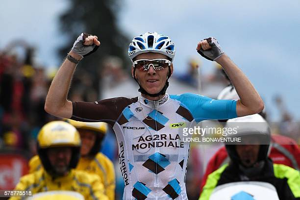 France's Romain Bardet celebrates as he crosses the finish line at the end of the 146 km nineteenth stage of the 103rd edition of the Tour de France...