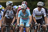 France's Romain Bardet Italy's champion Vincenzo Nibali and Poland's world champion Michal Kwiatkowski ride in the pack during the 101st...