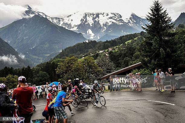 France's Romain Bardet rides as fans cheer during the 146 km nineteenth stage of the 103rd edition of the Tour de France cycling race on July 22 2016...
