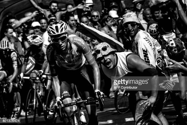 France's Romain Bardet rides in a breakaway past supporters cheering during the 1895 km fifteenth stage of the 104th edition of the Tour de France...