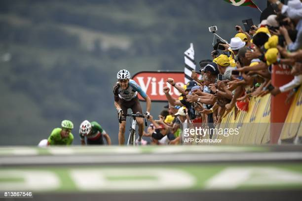 France's Romain Bardet rides towards the finish line ahead of Italy's Fabio Aru and Colombia's Rigoberto Uran at the end of the 2145 km twelfth stage...