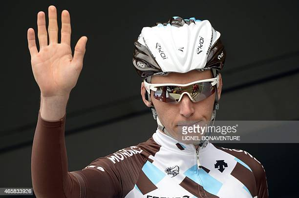 France's Romain Bardet waves on stage during the signature ceremony before the start of the third stage of the 73rd edition of the ParisNice cycling...