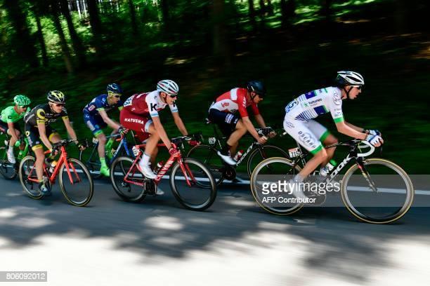 France's Romain Hardy Australia's Adam Hansen Germany's Nils Politt Belgium's Frederik Backaert France's Romain Sicard and USA's Nathan Brown ride in...