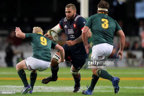 France's Romain Taofifenua holds the ball during the International test match between South Africa and France at the Kingspark rugby stadium on June...