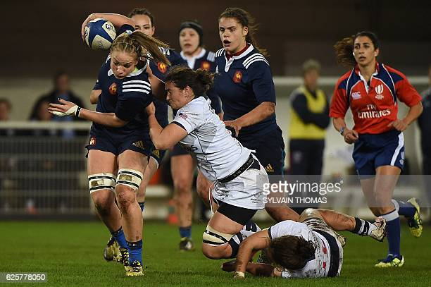 France's Romane Menager is tackled by US Kate Daley during the women's rugby union Test match between France and USA at the Altrad Stadium in...