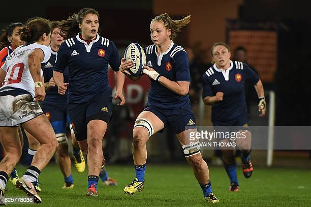 France's Romane Menager runs with a ball during the women's rugby union Test match between France and USA at the Altrad Stadium in Montpellier...