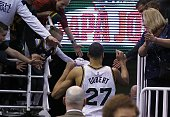 France's Rudy Gobert of the Utah Jazz high five's fans after the NBA game against the Houston Rockets at Energy Solutions Arena in Salt Lake City...