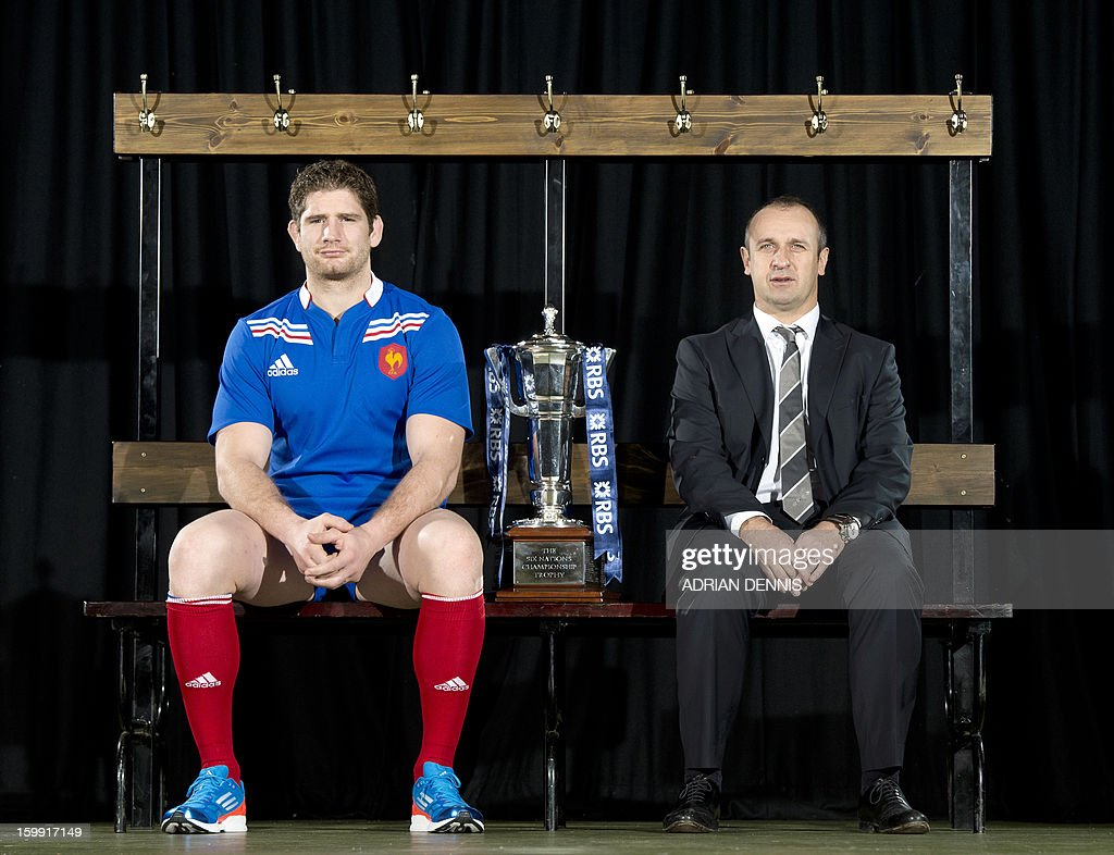 France's rugby captain Pascal Pape (L) and coach Philippe Saint-Andre (R) pose for photographs during the official launch of the 2013 Six Nations International rugby tournament at the Hurlingham Club in London on January 23, 2013. The tournament kicks-off February 2 with Wales versus Ireland. AFP PHOTO / ADRIAN DENNIS