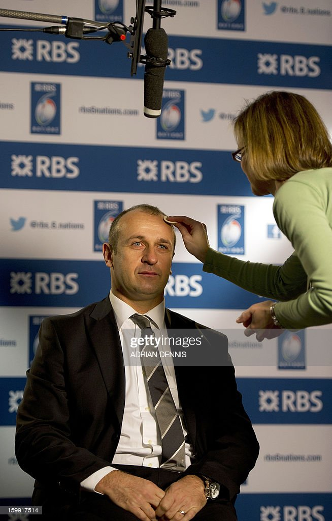 France's rugby coach Philippe Saint Andre has powder applied to his face ahead of a television interview during the official launch of the 2013 Six Nations International rugby tournament at the Hurlingham Club in London on January 23, 2013. The tournament kicks-off February 2 with Wales versus Ireland. AFP PHOTO / ADRIAN DENNIS