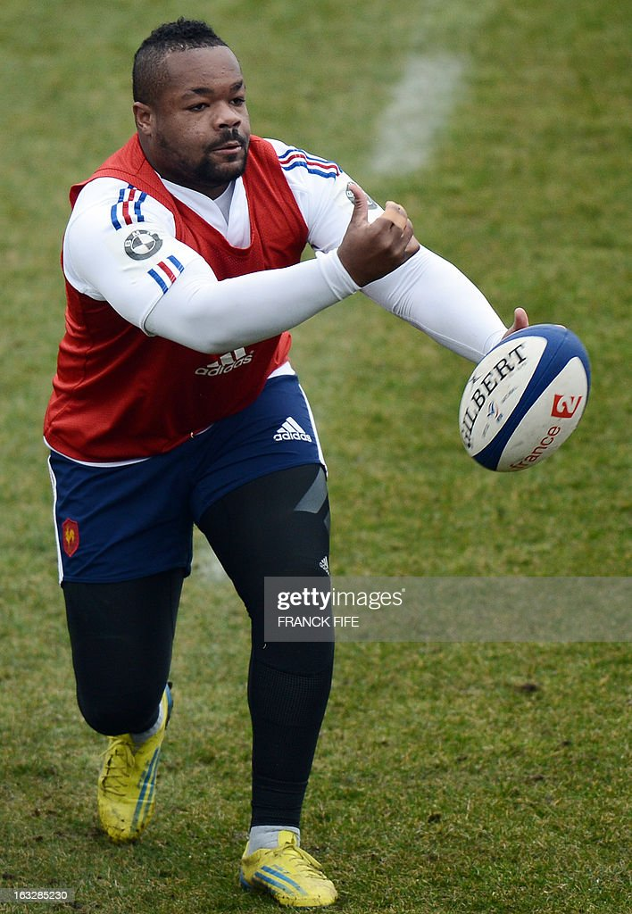 France's rugby union national team centre Mathieu Bastareaud passes the ball during a training session on March 7, 2013 in Marcoussis, south of Paris, as part of the preparation for the Six Nations rugby union tournament. France will play Ireland in their 2013 Six nations rugby match on March 23, 2013 in Lansdowne Road. AFP PHOTO / FRANCK FIFE