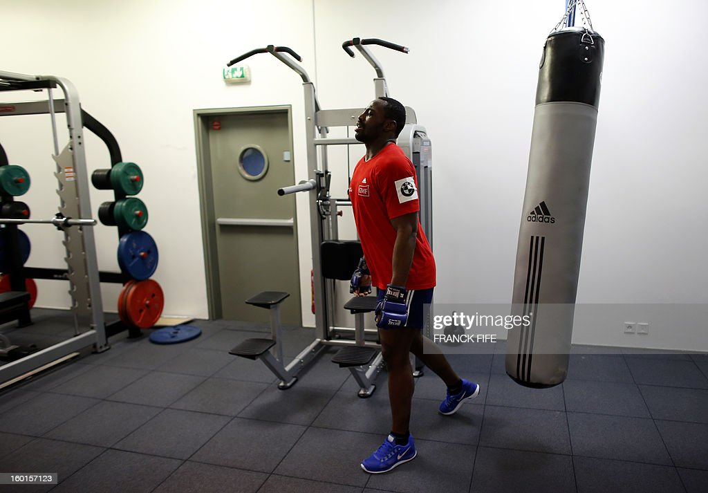France's rugby union national team flanker Fulgence Ouedraogo warms up during an indoor training session, on January 27, 2013 in Marcoussis, south of Paris, as part of the preparation of the Six Nations rugby tournament. France will play Italy in their 2013 six nations' rugby match on February 3, 2013.