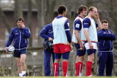 France's rugby union national team head coach Marc Lievremont and assistant coach Didier Retiere drive their team during a training session on March...