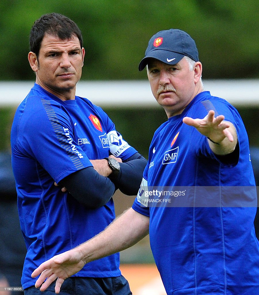France's rugby union national team head coach Marc Lievremont(L) speaks with defense coach David Ellis during a training session on July 14, 2011 in Chambon sur Lignon, as part of the preparation for the upcoming World Cup 2011.