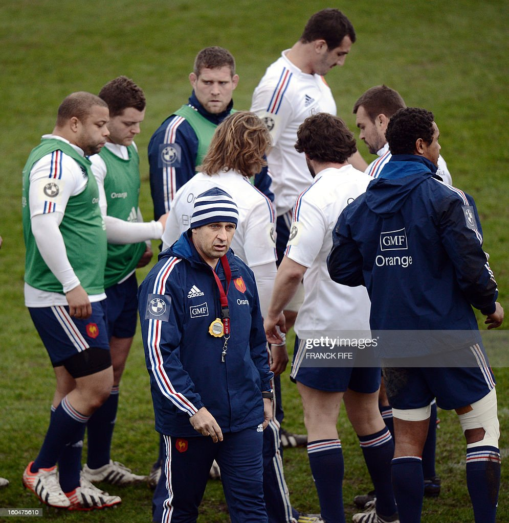 France's rugby union national team head coach Philippe Saint Andre (bottoml C) attends a training session on February 1, 2013 in Marcoussis, south of Paris, two days ahead of their 2013 six nations' rugby union match against Italy.
