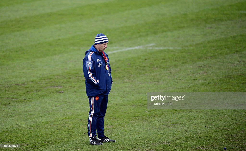 France's rugby union national team head coach Philippe Saint Andre grimaces during a training session, on February 1, 2013 in Marcoussis, south of Paris as part of the preparation of the Six Nations rugby union tournament. France will play against Italy in their 2013 six nations' rugby match on February 3, 2013. AFP PHOTO / FRANCK FIFE