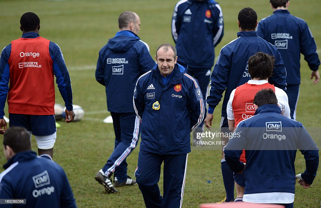 France's rugby union national team head coach Philippe Saint Andre (C) attends a training session on March 7, 2013 in Marcoussis, south of Paris, ahead of a 2013 Six Nations tournament match against Ireland on March 23 at Lansdowne Road.