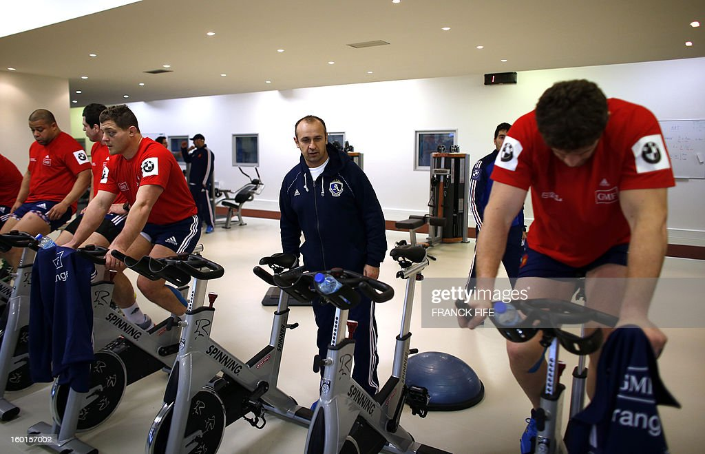 France's rugby union national team head coach Philippe Saint Andre (C) looks as his players during an indoor training session, on January 27, 2013 in Marcoussis, south of Paris, as part of the preparation of the Six Nations rugby tournament. France will play Italy in their 2013 six nations' rugby match on February 3, 2013.