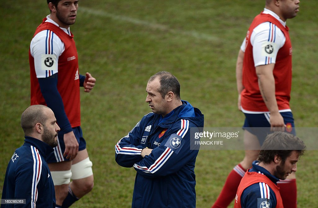 France's rugby union national team head coach Philippe Saint Andre (C) looks at his players during a training session on March 7, 2013 in Marcoussis, south of Paris, ahead of a 2013 Six Nations tournament match against Ireland on March 23 at Lansdowne Road.
