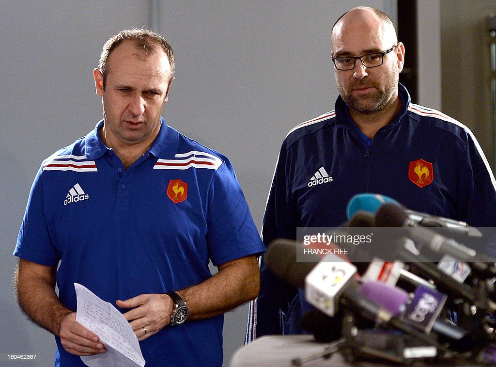France's rugby union national team head coach Philippe Saint-Andre attends a press conference with press officer Lionel Rossigneux on February 1, 2013 in Marcoussis, south of Paris as part of the preparation of the Six Nations rugby union tournament. France will play Italy in their 2013 six nations' rugby match on February 3, 2013.