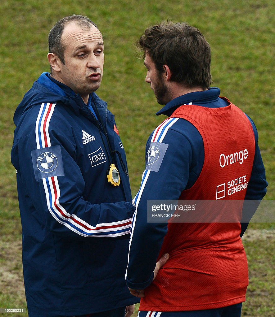 France's rugby union national team head coach Philippe Saint-Andre (L) speaks with left wing Maxime Medard during a training session on March 7, 2013 in Marcoussis, south of Paris, as part of the preparation for the Six Nations rugby union tournament. France will play Ireland in their 2013 Six nations rugby match on March 23, 2013 in Lansdowne Road.