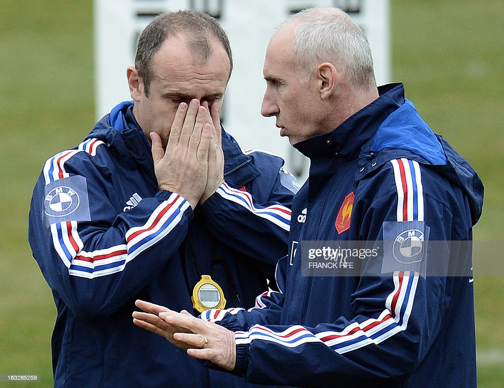 France's rugby union national team head coach Philippe Saint-Andre (L) reacts next to assistant coach Patrice Lagisquet during a training session on March 7, 2013 in Marcoussis, south of Paris, as part of the preparation for the Six Nations rugby union tournament. France will play Ireland in their 2013 Six nations rugby match on March 23, 2013 in Lansdowne Road.