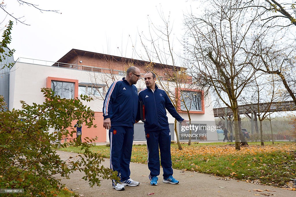France's rugby union national team head's coach Philippe Saint-Andre (R) and press officer Lionel Rossigneux leave a press conference, on November 22, 2012 in Marcoussis, south of Paris, to present the French squad to face Samoa on November 24, 2012 at the Stade de France, in Saint-Denis. AFP PHOTO / FRANCK FIFE