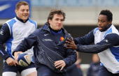 France's Rugby Union national team hooker Sylvain Marconnet vies with flanker Fulgence Ouedraoggo during a training session on February 23 2009 in...