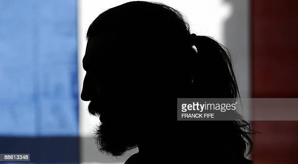 France's rugby union national team lock Sebastien Chabal is silhouetted as he takes part in a press conference in Wellington on June 17 2009 as the...