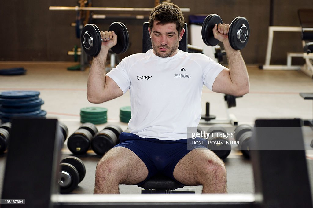 France's rugby union national team player Florian Fritz works out during an indoor training session on March 5, 2013 in Marcoussis, south of Paris, as part of the preparation for the Six Nations rugby union tournament. France will play Ireland in their 2013 Six nations rugby match on March 09, 2013.