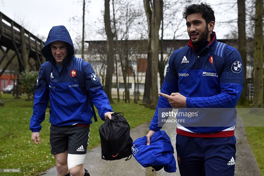 France's rugby union national team scrum half Maxime Machenaud (L) jokes with outside centre Maxime Mermoz as they arrive for a training session in Marcoussis, south of Paris on February 12, 2016 on the eve of their Rugby Union 6 Nations match against Ireland. / AFP / FRANCK FIFE