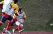France's rugby union national team winger Marc Andreu runs with a ball during a training session on March 10 2010 in Marcoussis south of Paris as...